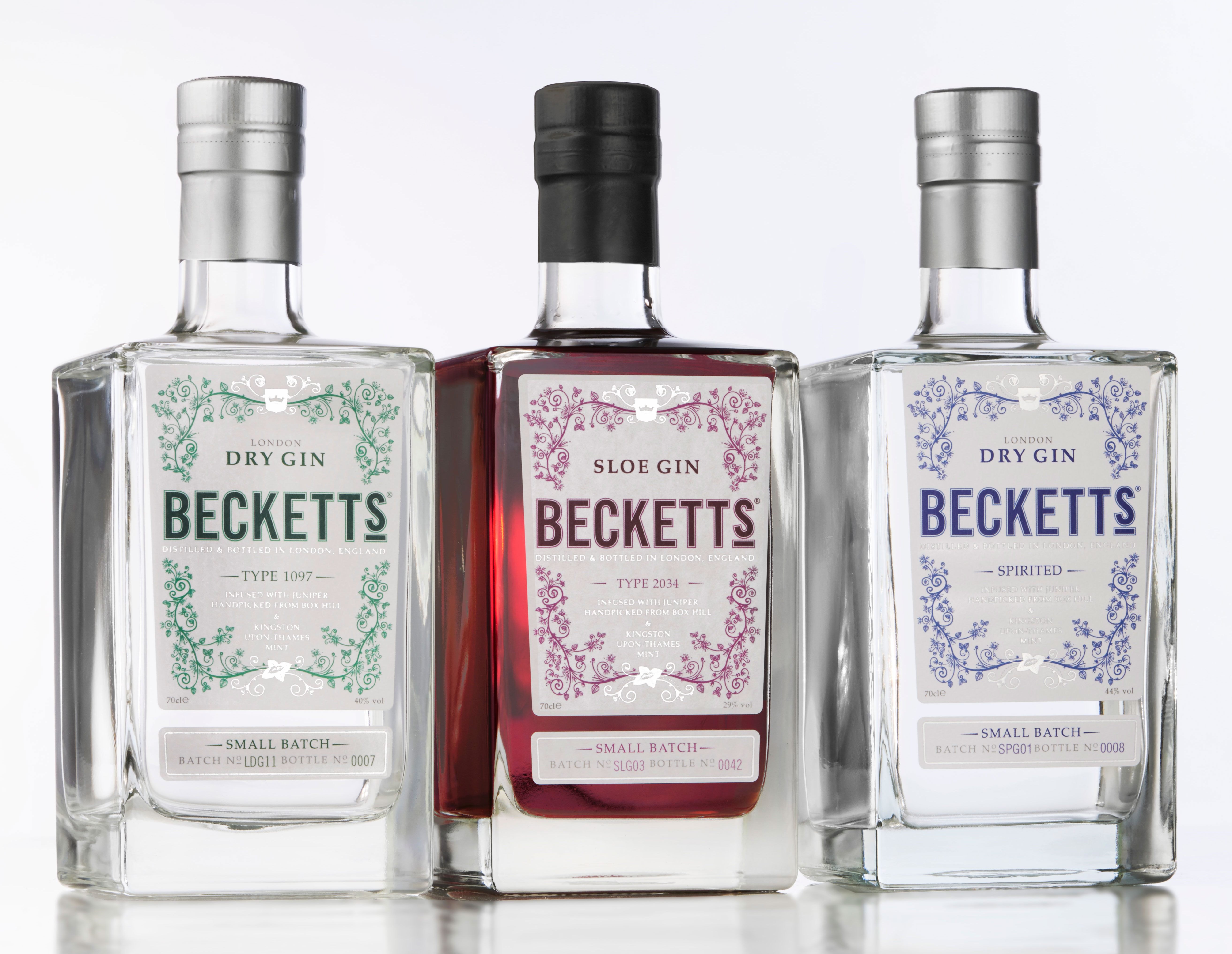 Becketts Gin bottles Spirited, Sloe Gin and London Gin on a white background
